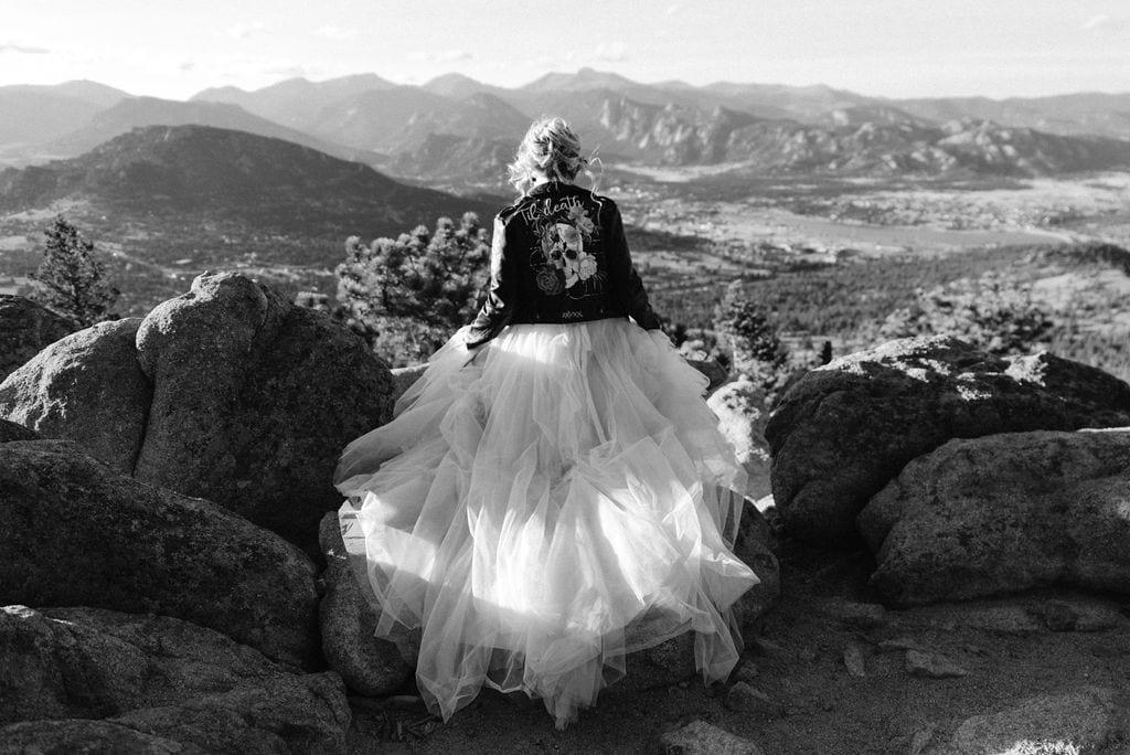 Bride on the edge of a mountain in estes park colorado