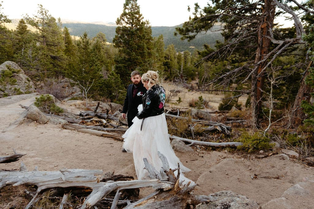 Bride and groom start to hike back down the mountain together