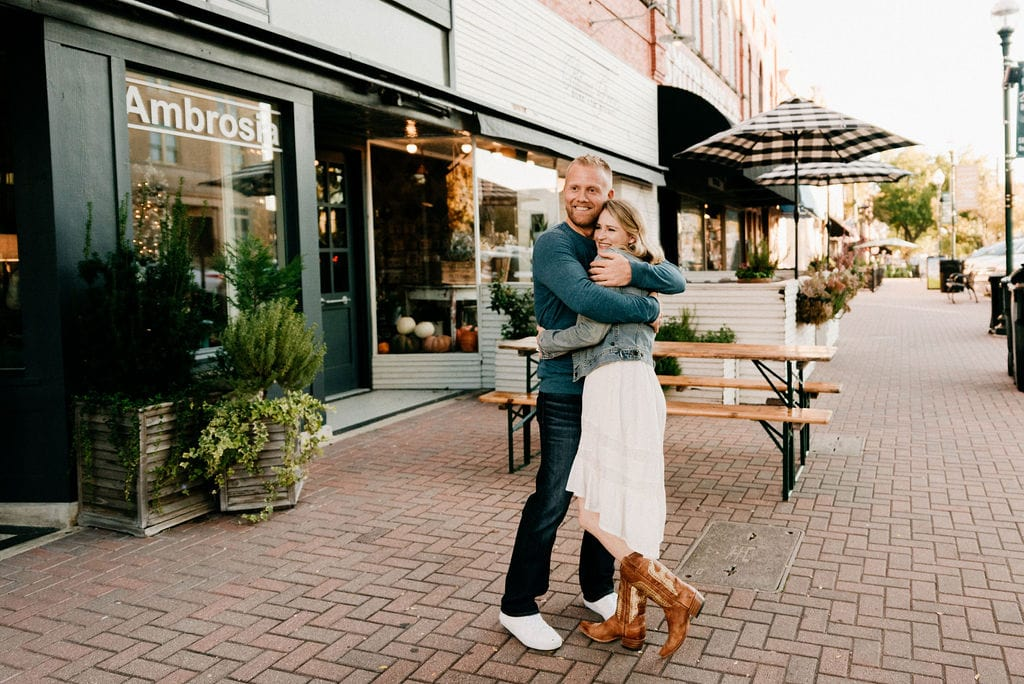 Couple Snuggles during engagement in mckinney texas
