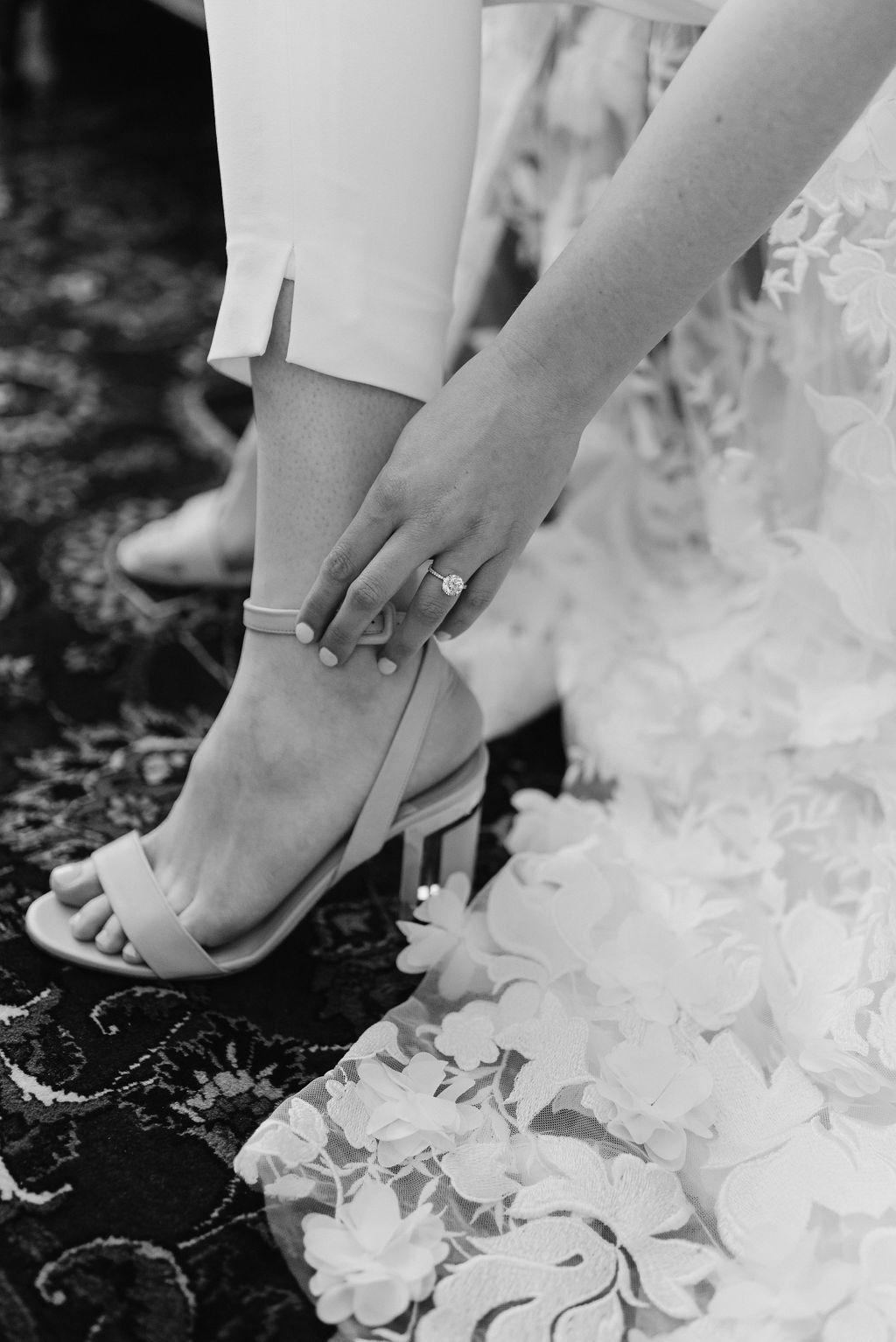 Bride getting on her shoes her Boulder Colorado Elopement