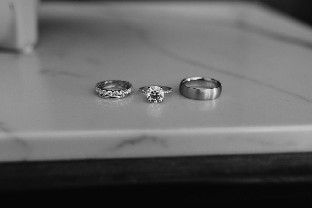 Wedding rings on table at The Ramble Hotel Denver Colorado Elopement