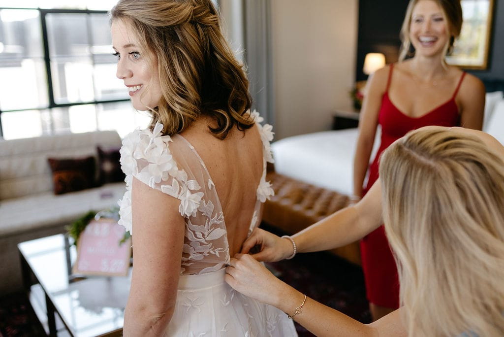 Bride getting on her bridal gown jumpsuit before her Boulder Colorado Elopement
