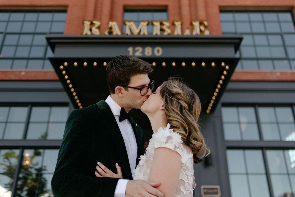 Couple Kissing outside the ramble hotel in denver before their boulder colorado elopement