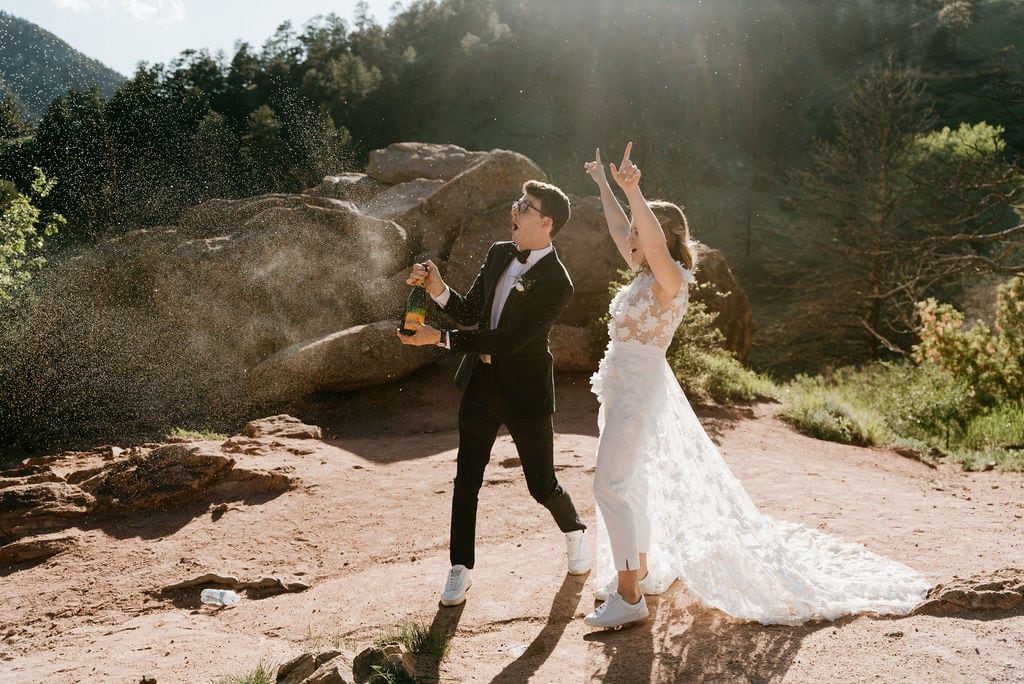 Popping Champagne at Boulder Colorado Elopement at Settlers Park at Sunset