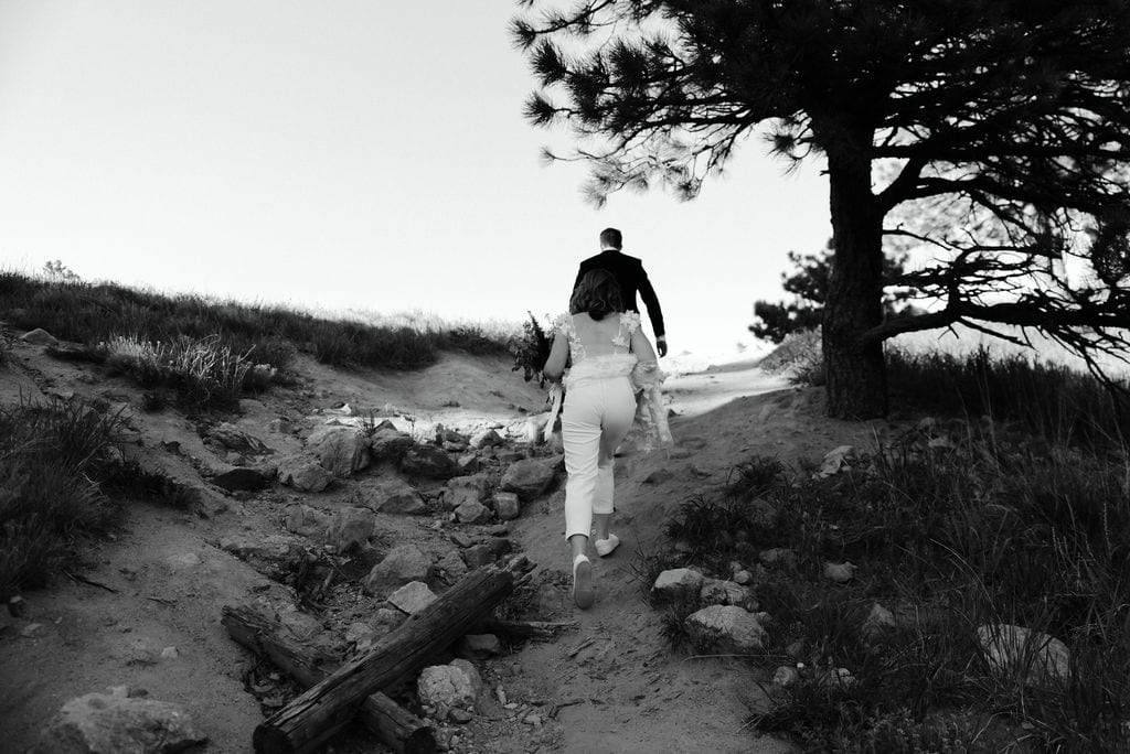 Couple Hiking on wedding day at their boulder colorado elopement at settlers park