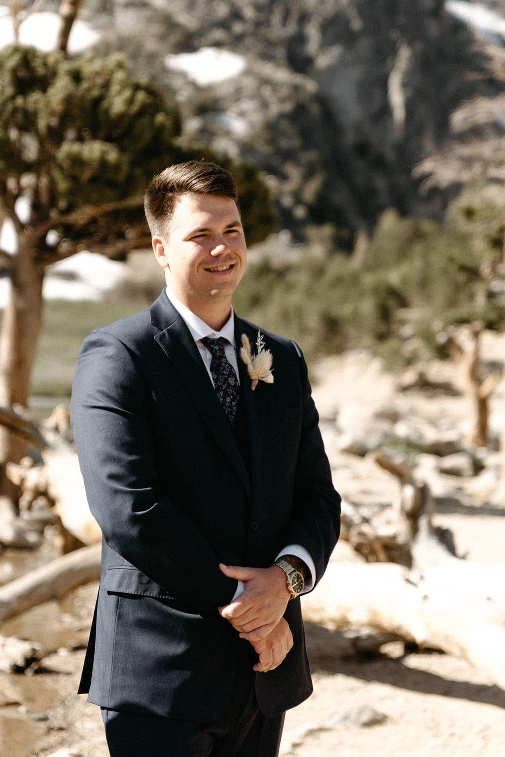 Groom waits for bride at St Mary's Glacier elopement in Idaho Springs Colorado