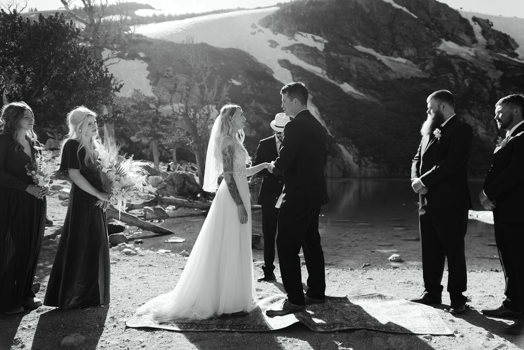 Couple exchanges rings at st marys glacier elopement