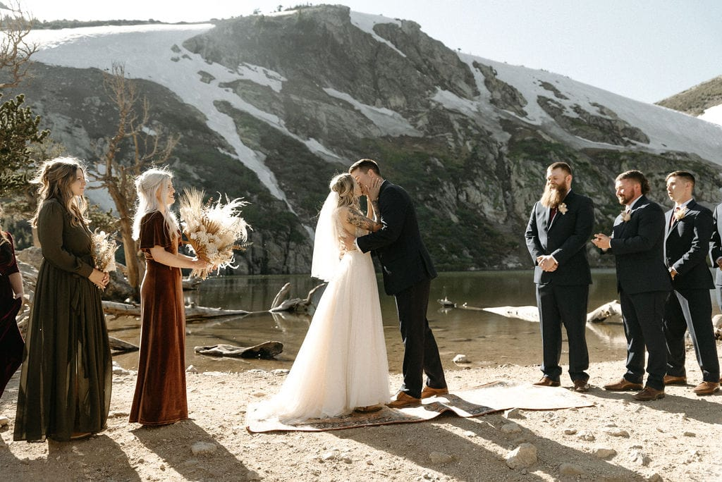 Couples first kiss as bride and groom at St Mary's Glacier Wedding