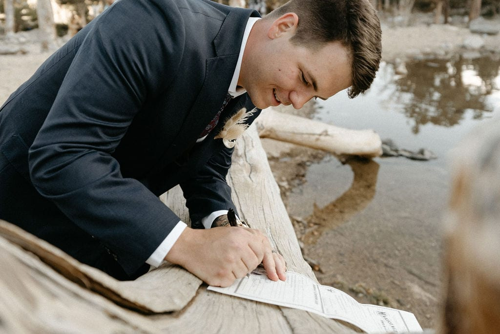 signing marriage license at colorado elopement
