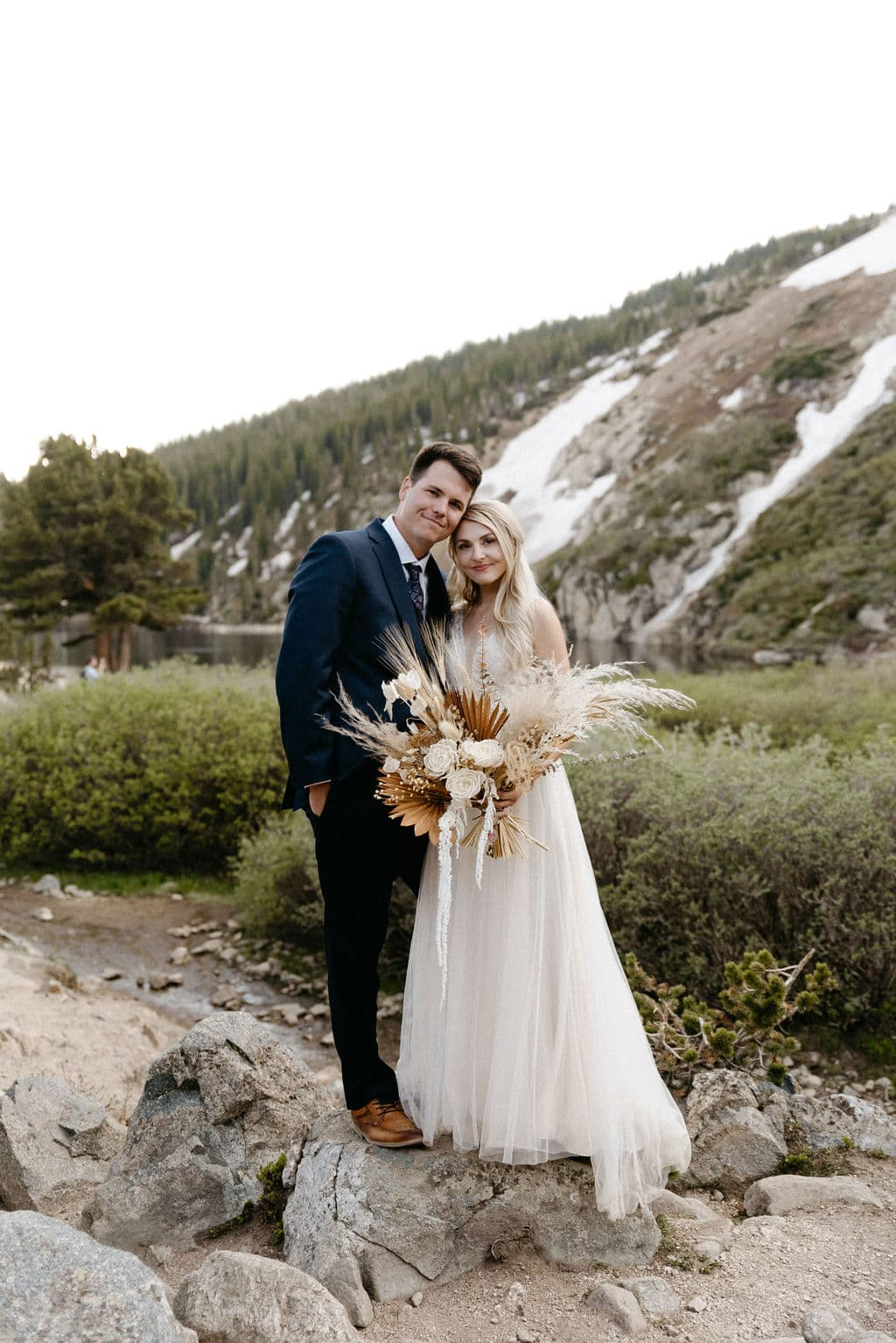 Couple just married at St Mary's Glacier in Colorado