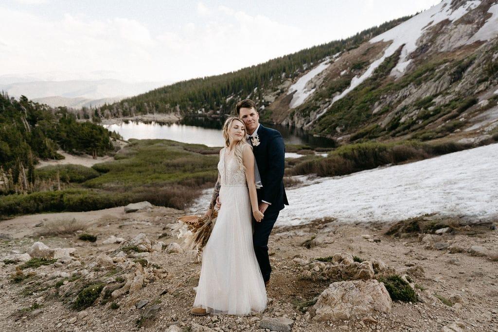 Romantic wedding portraits above St marys Glacier Lake in Colorado