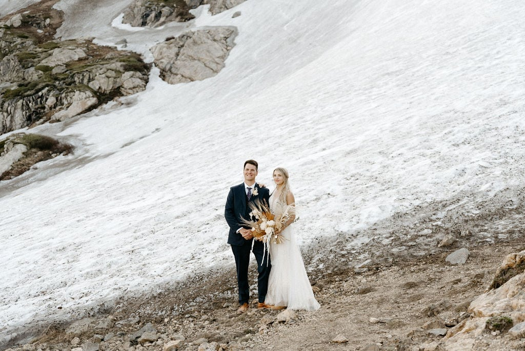 Wedding Couple hikes to St Marys Glacier in Colorado