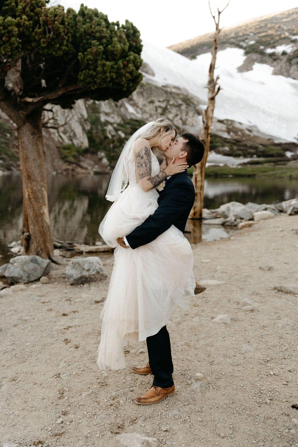 Couple Kisses after colorado mountain Elopement