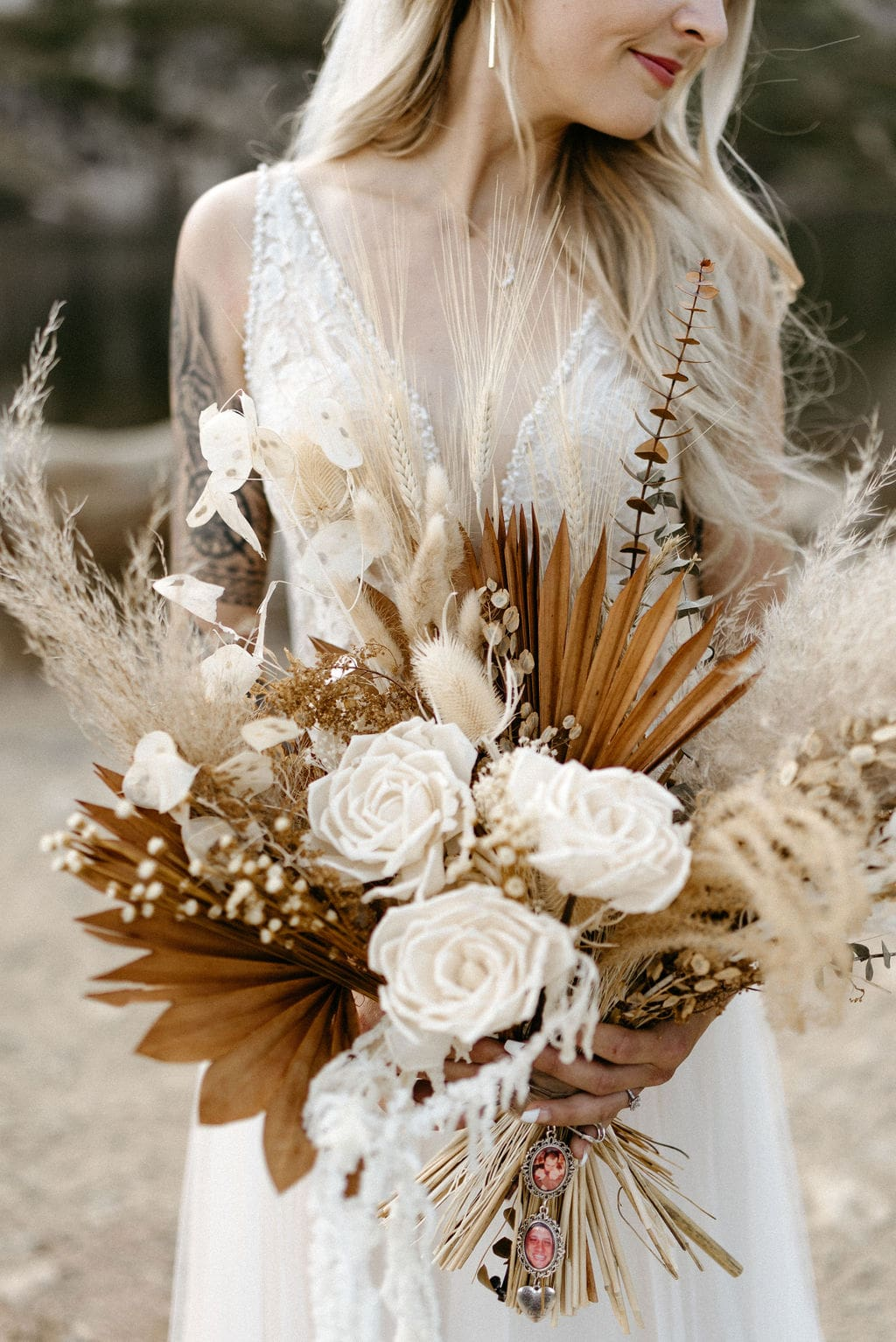 beautiful Bride with dried flowers at her colorado elopement in the mountains