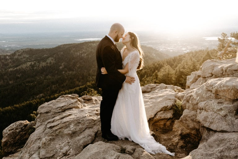 Couple on mountain top in boulder
