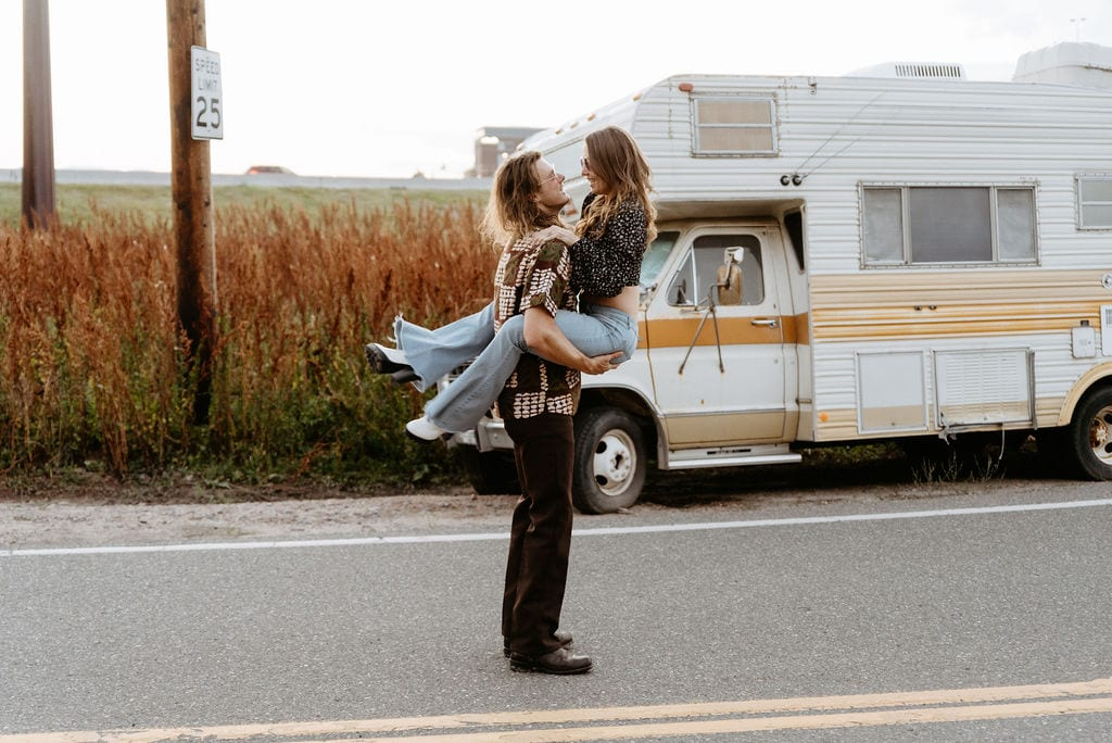 Girl running and jumping into her fiances arms during retro denver engagement session
