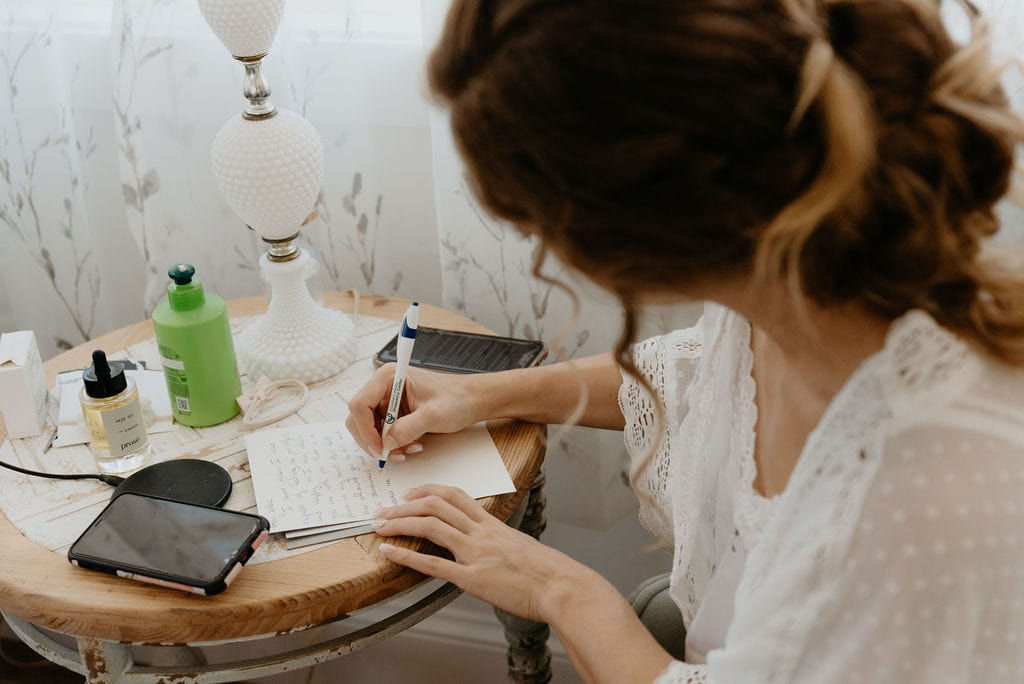 Bride writing a letter to her groom
