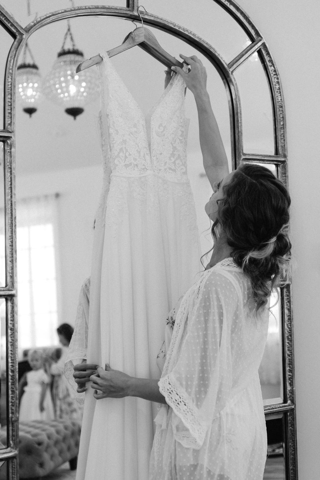 Bride gets ready to put her dress on