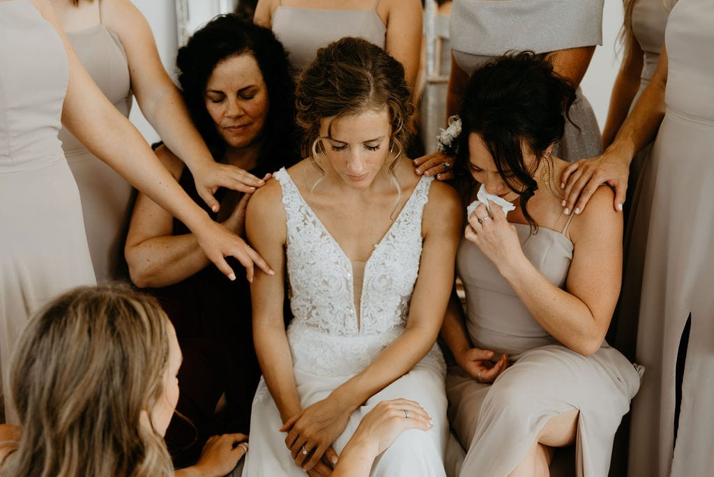Bride and her Bridesmaids Praying with the Bride before bonnie blues wedding