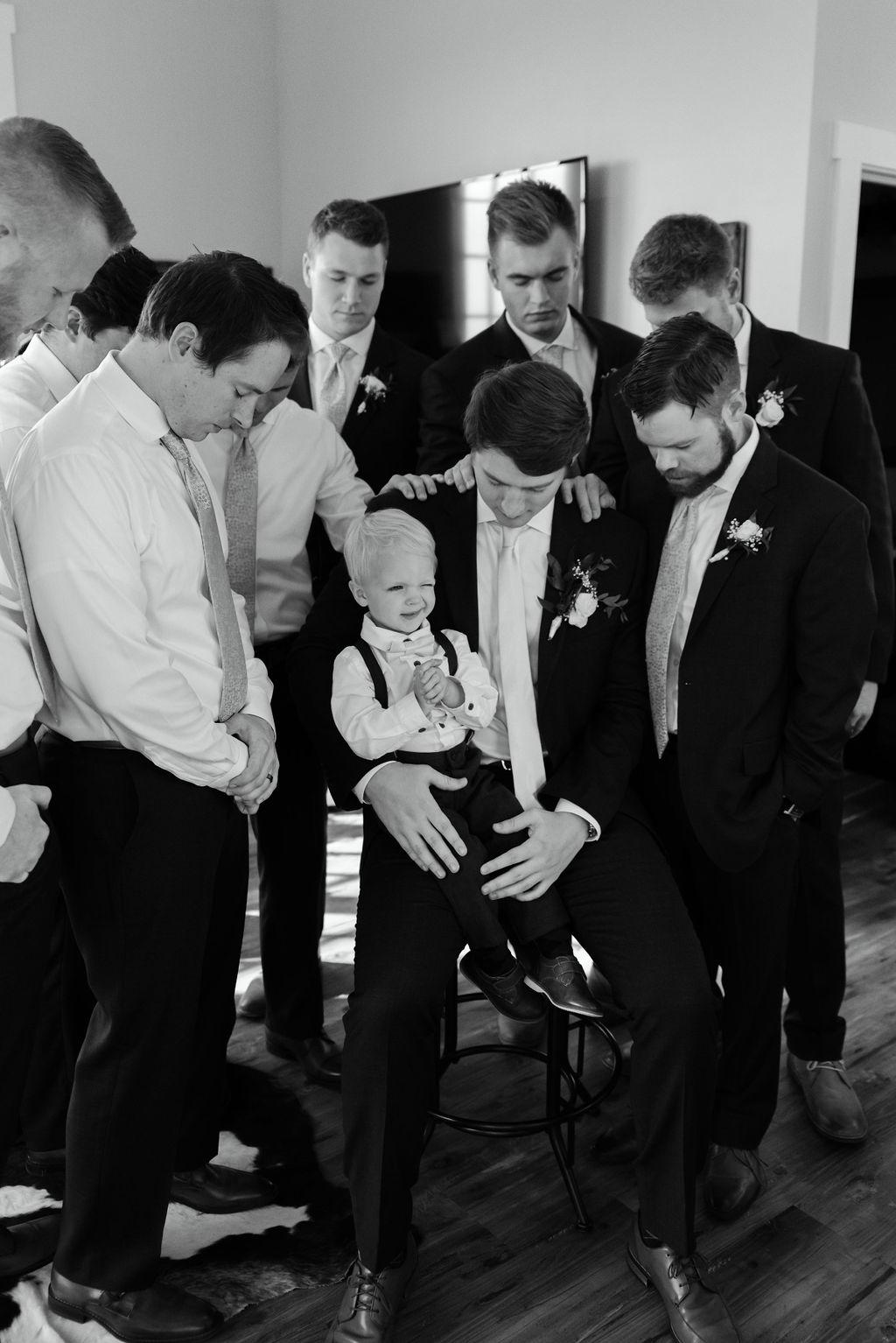Groomsmen Praying with the Groom before bonnie blues wedding