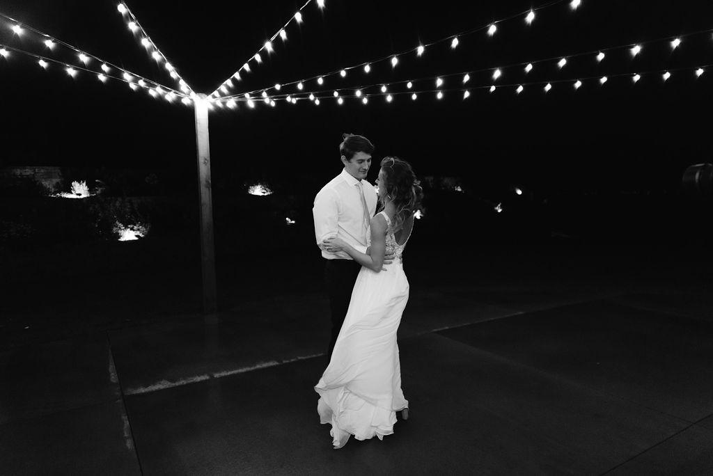 Romantic First Dance Under String Lights at Bonnie Blues Event Venue