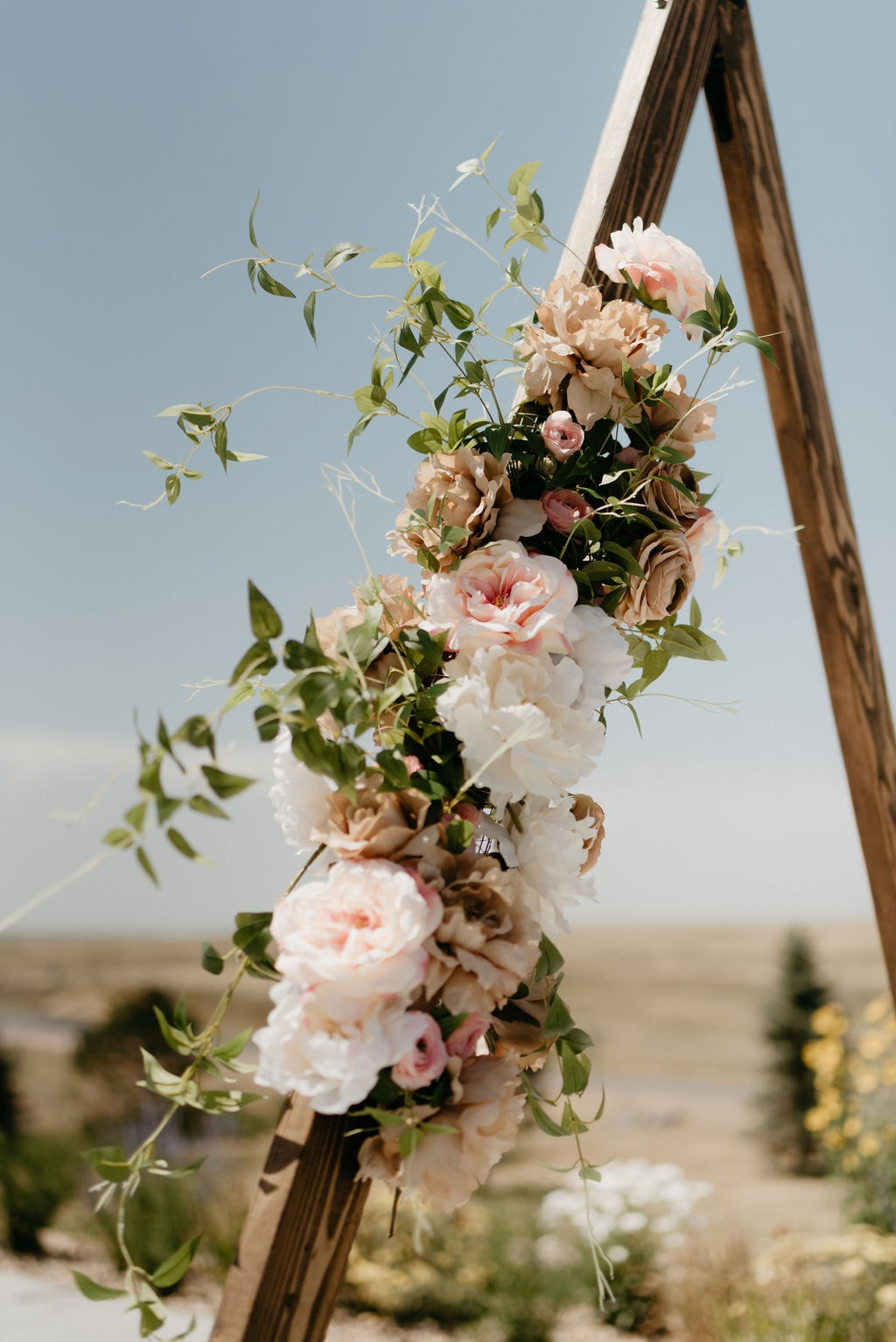 Handmade Mountain Wedding Arch Made by the Brides Family for their Bonnie Blues Event Venue Wedding