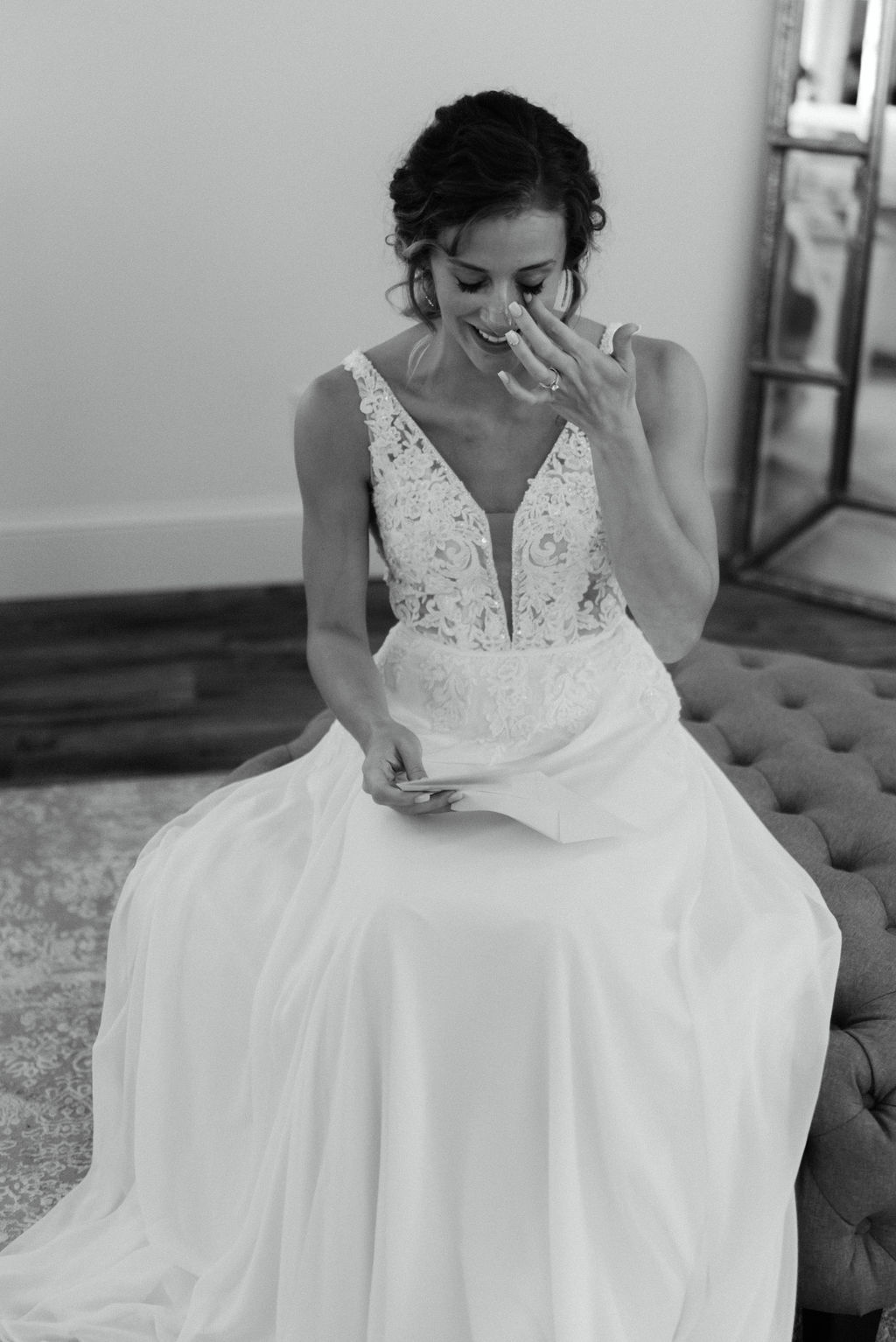 Bride cries while reading the letter her groom wrote her