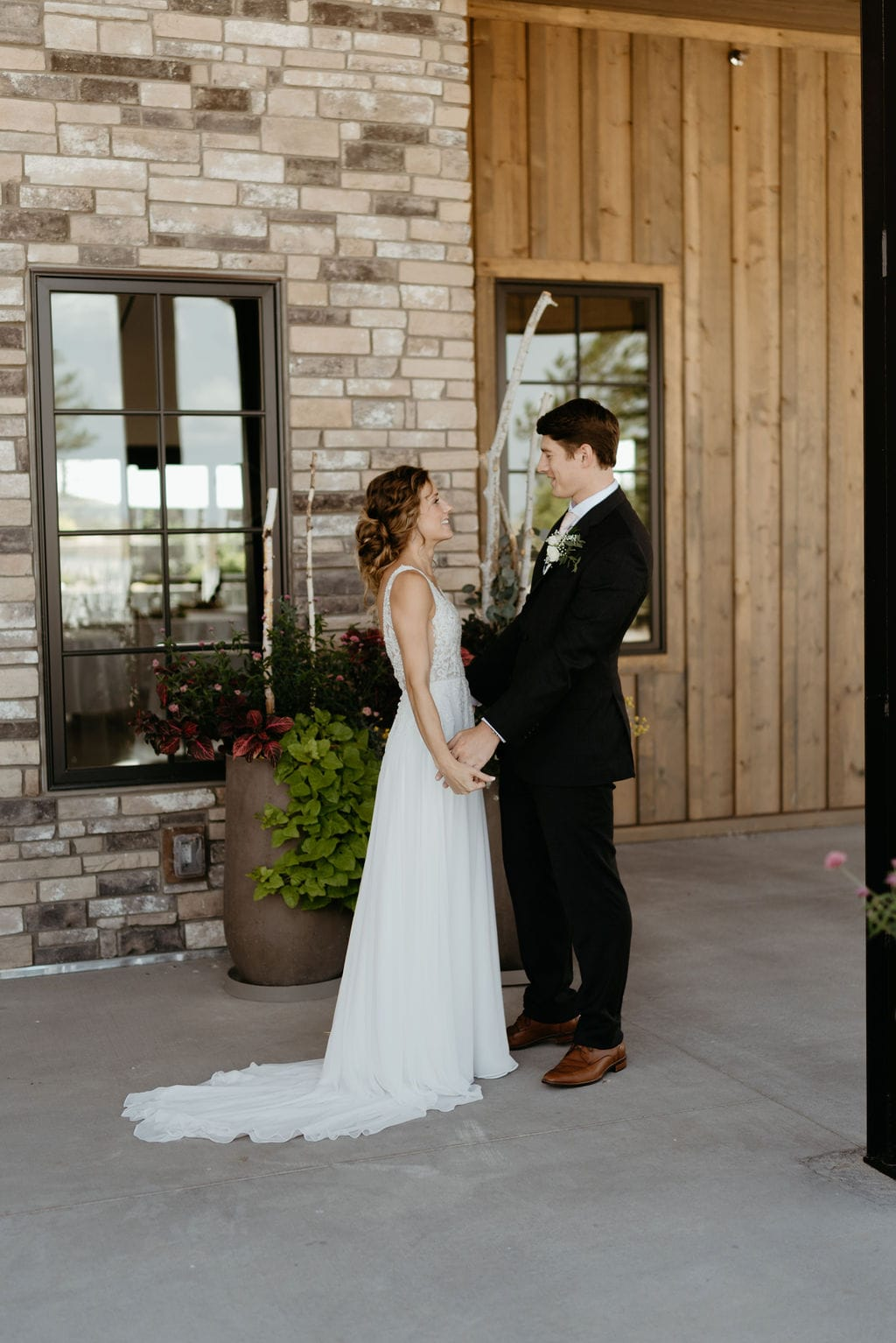 First look with the bride and groom under the covered patio at Bonnie Blues Event Venue