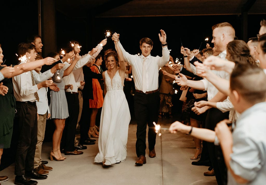 Sparkler Entrance onto dance floor under covered patio at bonnie blues event venue wedding